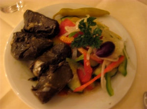 We started off with dolmas (grape leaves) and a light salad...