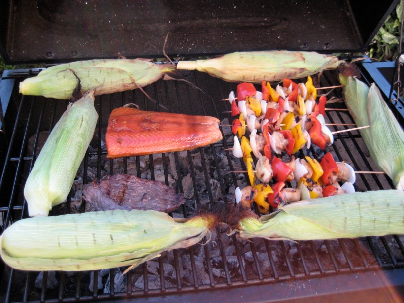 The beautiful grill, featuring corn, kabobs, a buffalo steak, and my salmon filet (marinated in pseudo-teriyaki)
