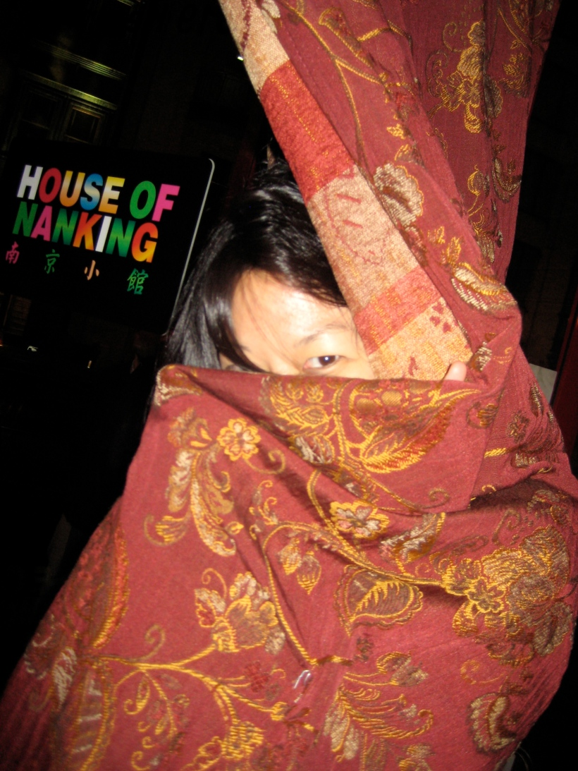 Waiting just inside the door at the House of Nanking.  It was cold so my friend decided to wrap herself in the curtain.