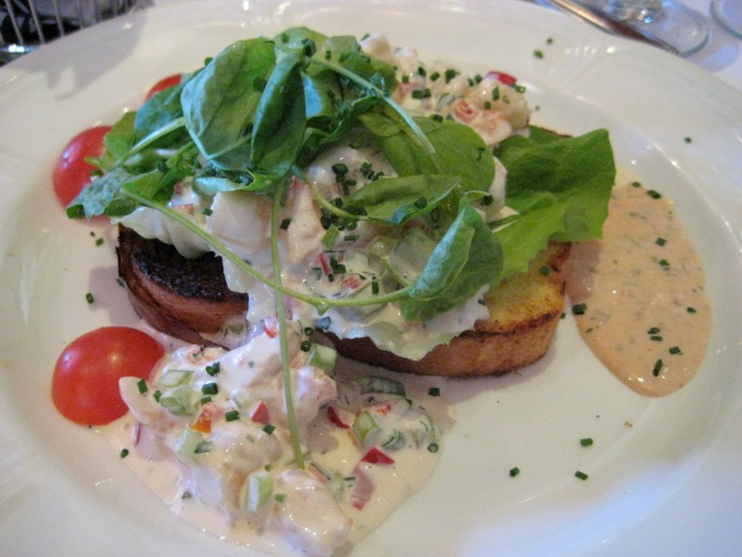 Open-faced shrimp salad sandwich with avocado (hidden by the spinach)