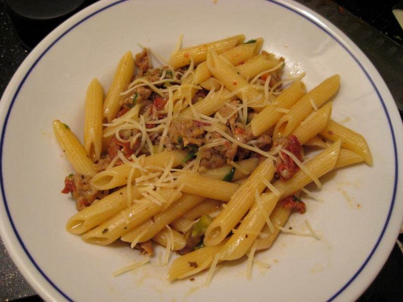Penne with sausage, asparagus, artichokes, AND sun-dried tomatoes, topped with freshly grated Parmesan.