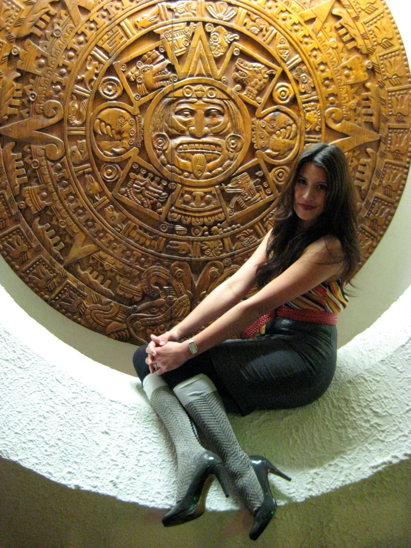 Giant Mayan sculptures are part of the decor at El Patio. (Pretty lady not a permanent part of the display.)