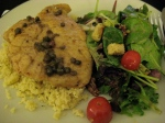 Fabulous homecooked meal: chicken piccata over couscous, with greens tossed in vinagrette.