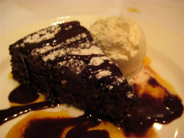 Chocolate and hazelnut cake with vanilla ice cream and chocolate and orange sauce.