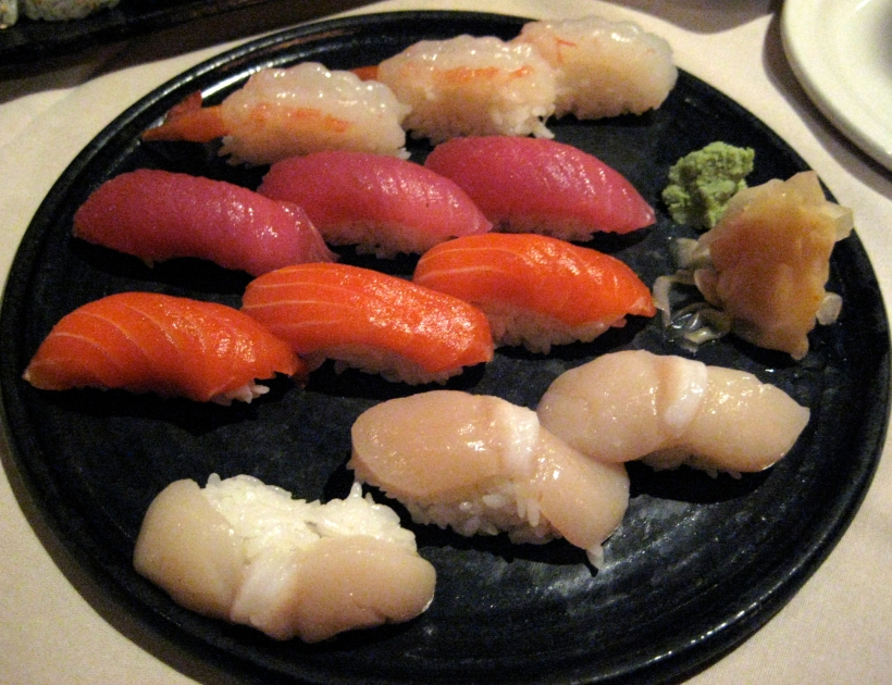 Nigiri (from top to bottom): sweet shrimp, tuna, salmon, and scallop.