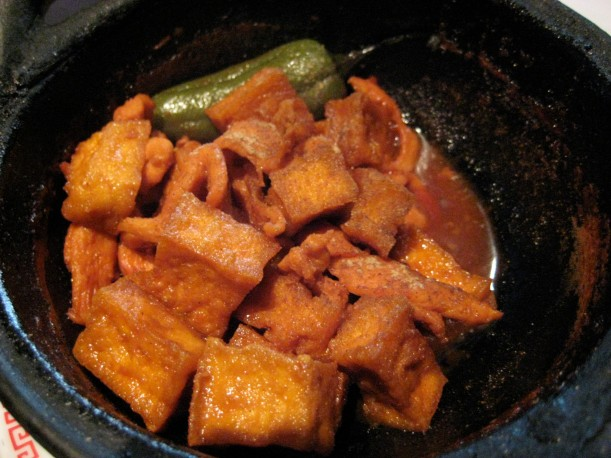 Clay pot with chicken and tofu.