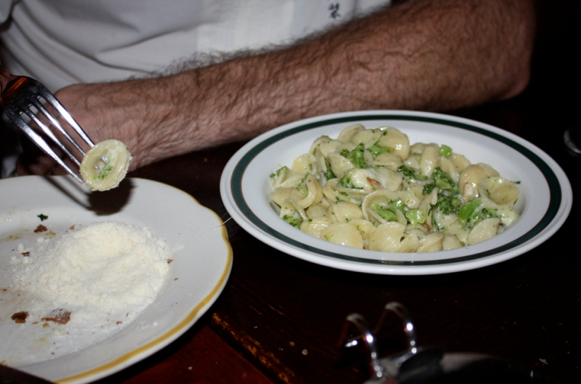 J has parmesan cheese with pasta on the side.