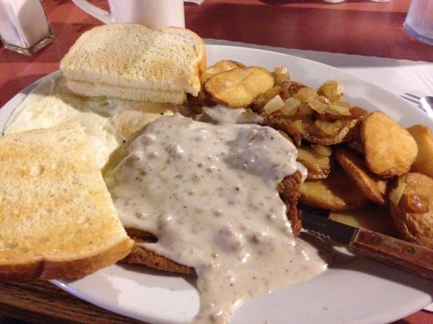 Chicken fried steak, gravy, and home fries at a local breakfast spot. #winning